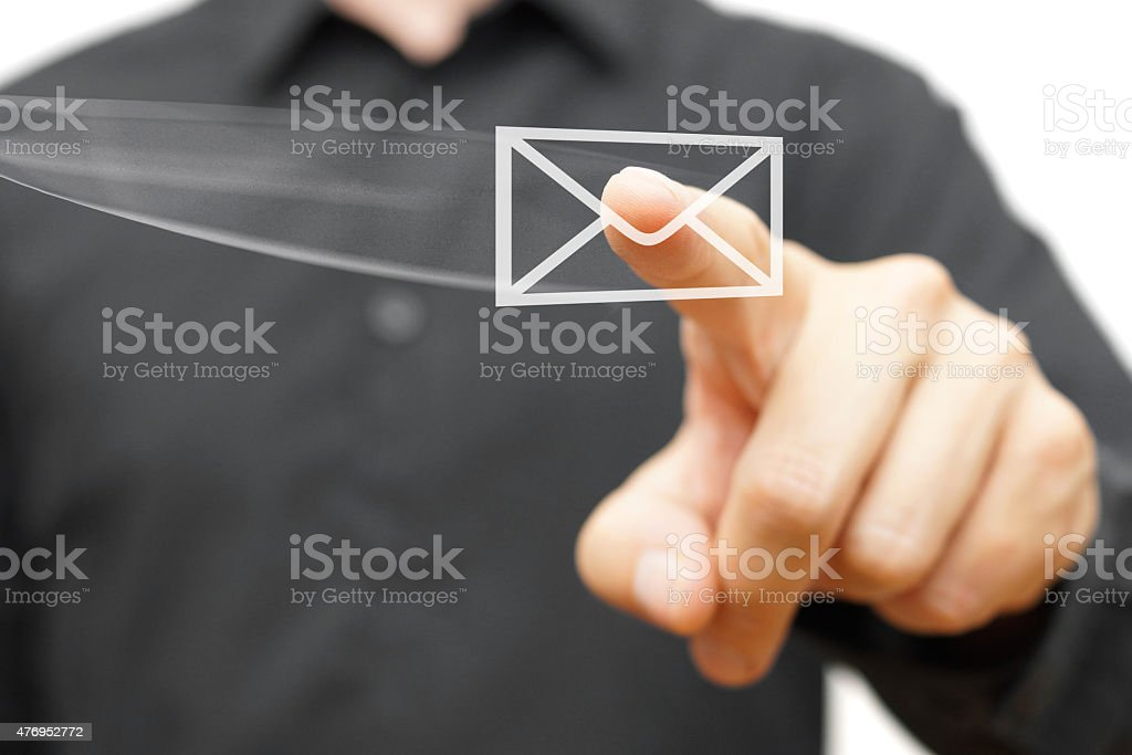 Businessman pressing flying virtual email icon stock photo