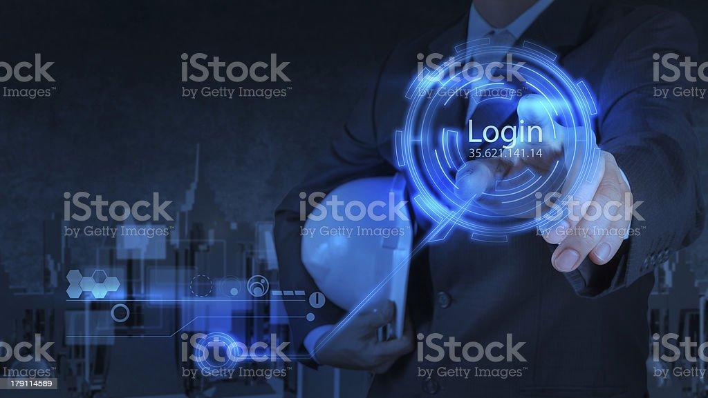 businessman pressing login button on internet royalty-free stock photo