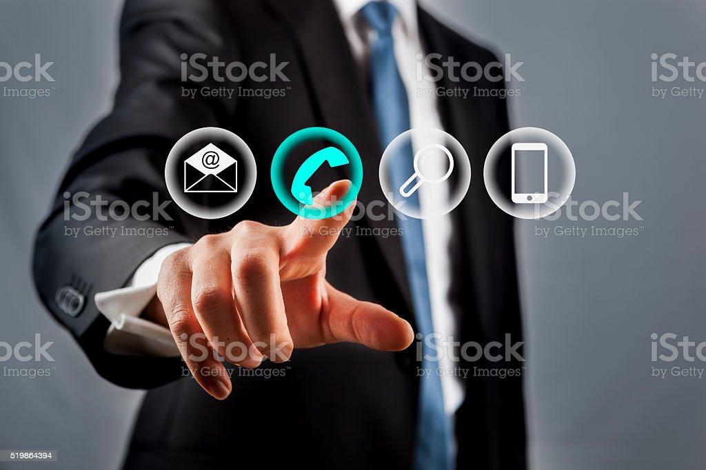 Businessman pressing phone button stock photo