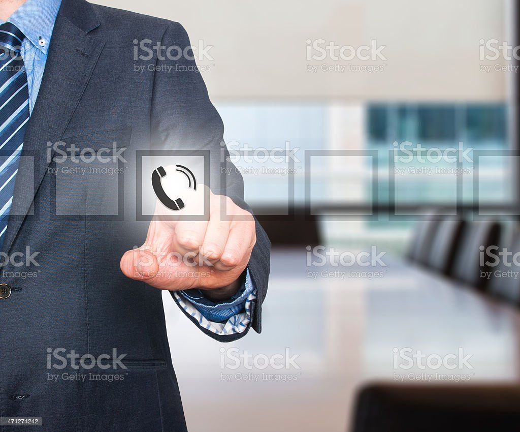 Businessman pressing phone button, visual screen. Communication concept stock photo
