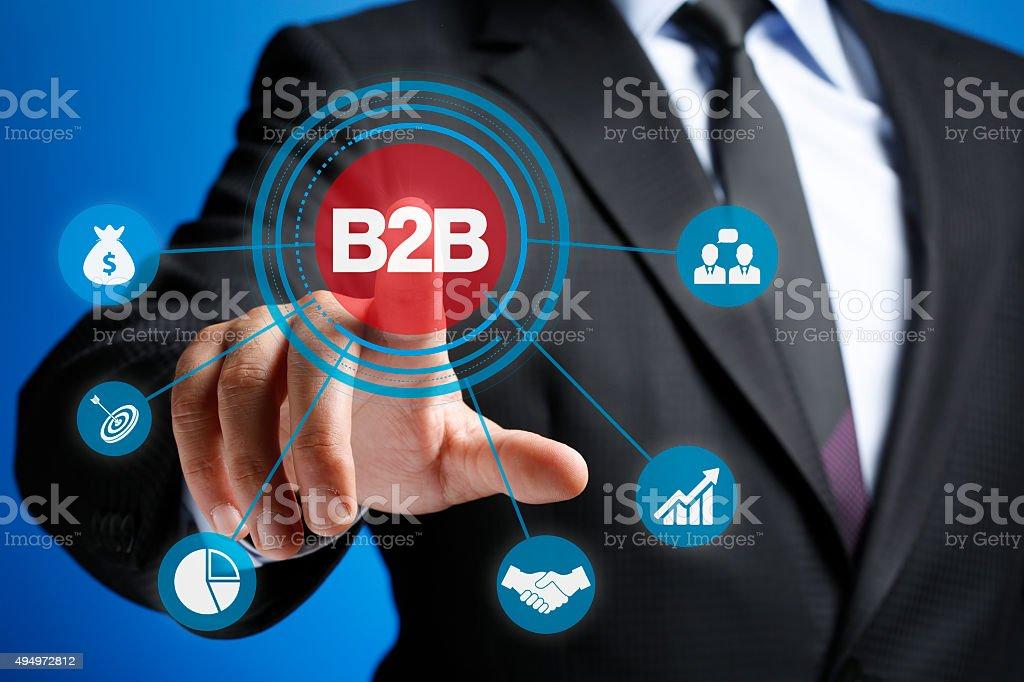 Businessman Pressing Sign Button B2B Virtual Set stock photo