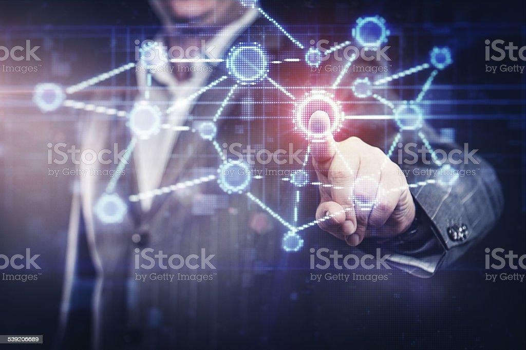 Businessman pressing social network button on modern digital display stock photo
