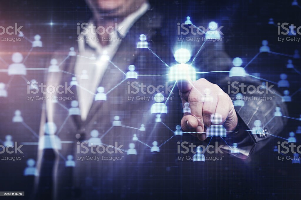 Businessman pressing social network button on modern digital display stock photo