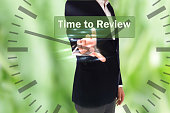 businessman pressing Time for Review button on virtual screens