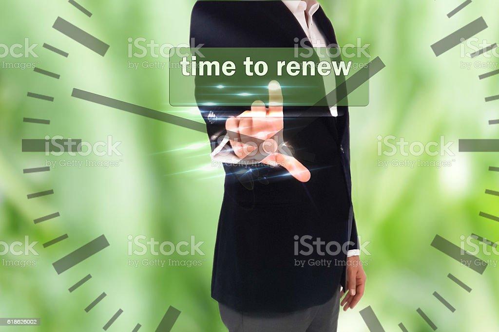 businessman pressing time to renew  button stock photo