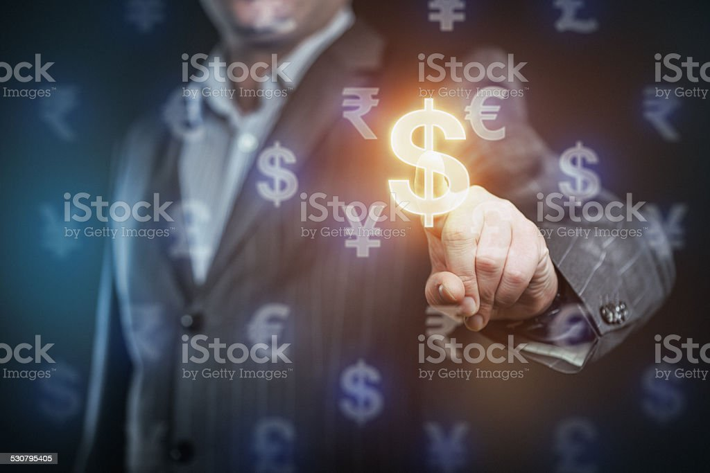 Businessman pressing US dollar symbol stock photo