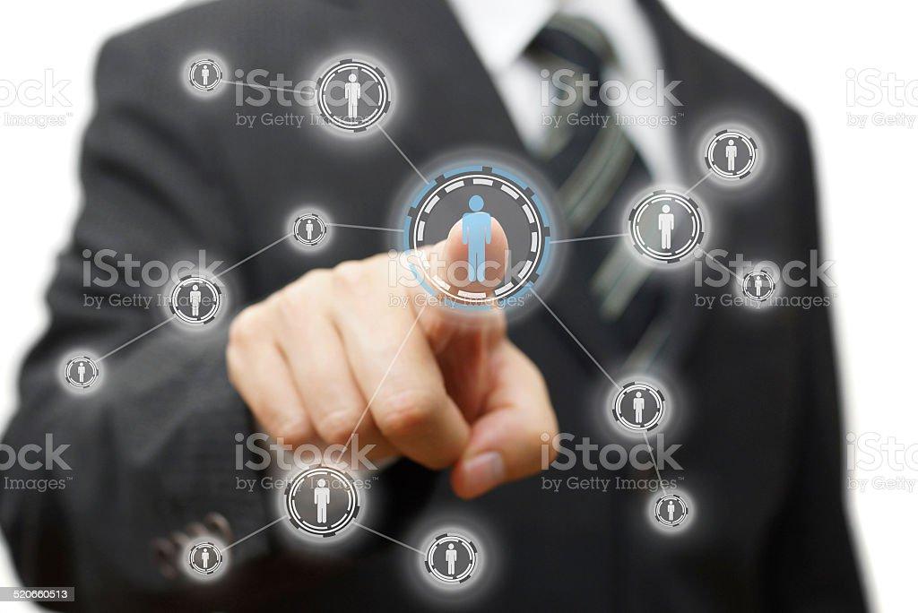 Businessman pressing virtual button on  screen. network,community stock photo