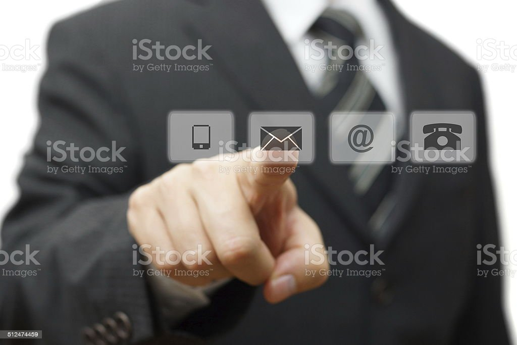 Businessman pressing virtual ( mail,phone,email ) buttons. cutomer support concept stock photo