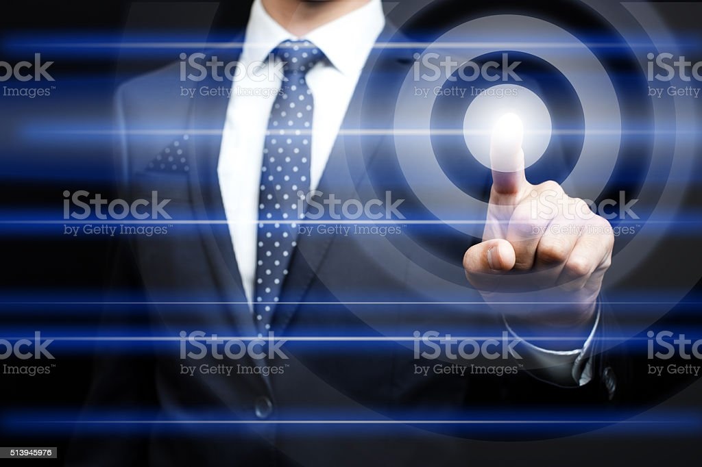 Businessman pressing virtual icons stock photo