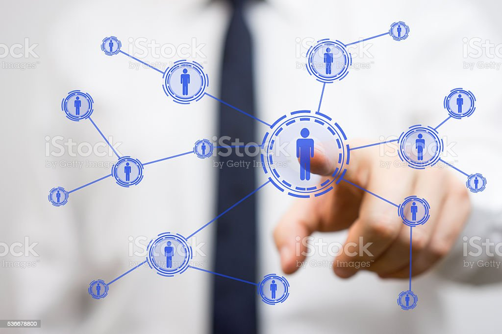 Businessman pressing  virtual networked person, connectivity and networking concept stock photo