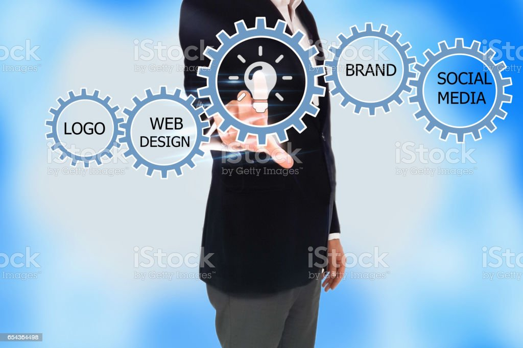 businessman pressing web button on virtual screens, wheels as symbols of business man, Business concept stock photo