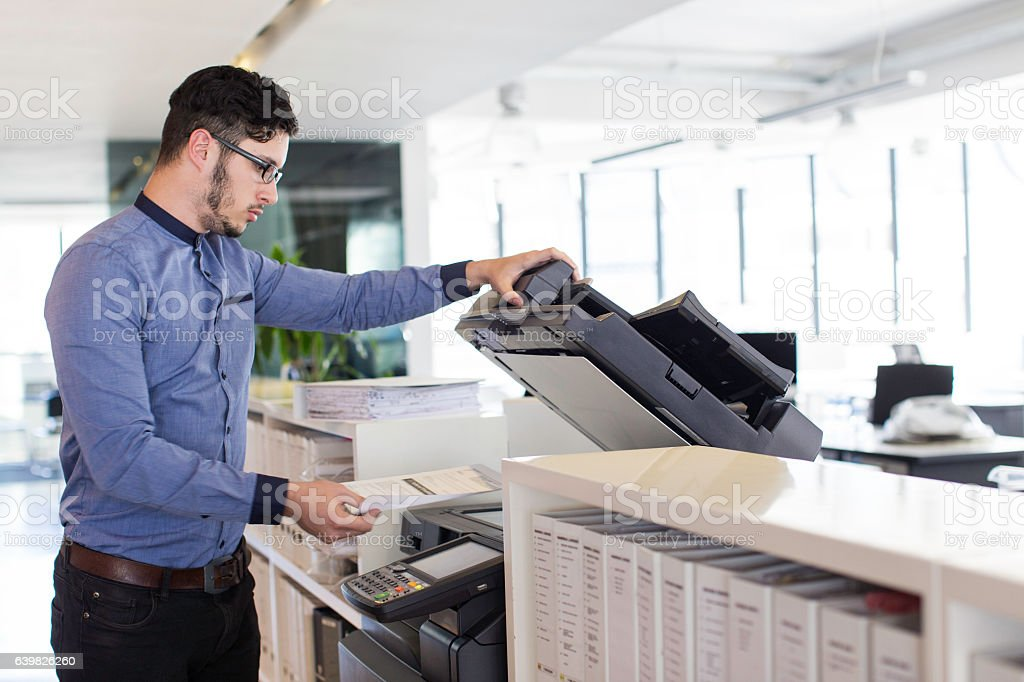 Businessman printing in the office. stock photo