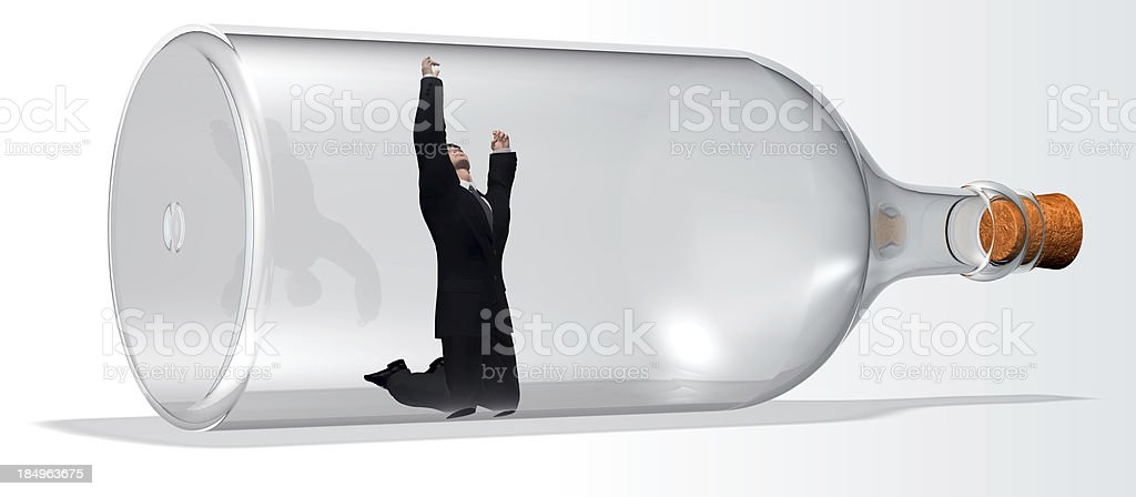 Businessman prisoner in a bottle royalty-free stock photo