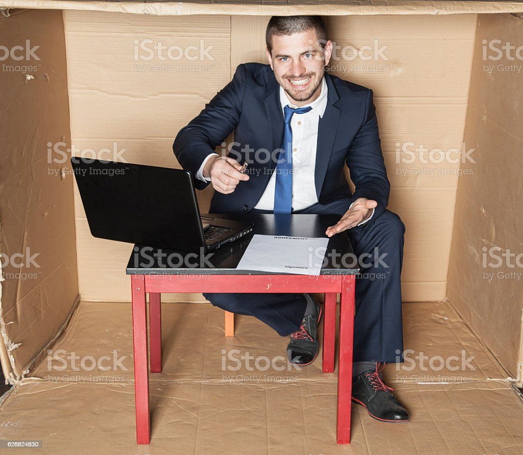 businessman proposes to sign a contract stock photo