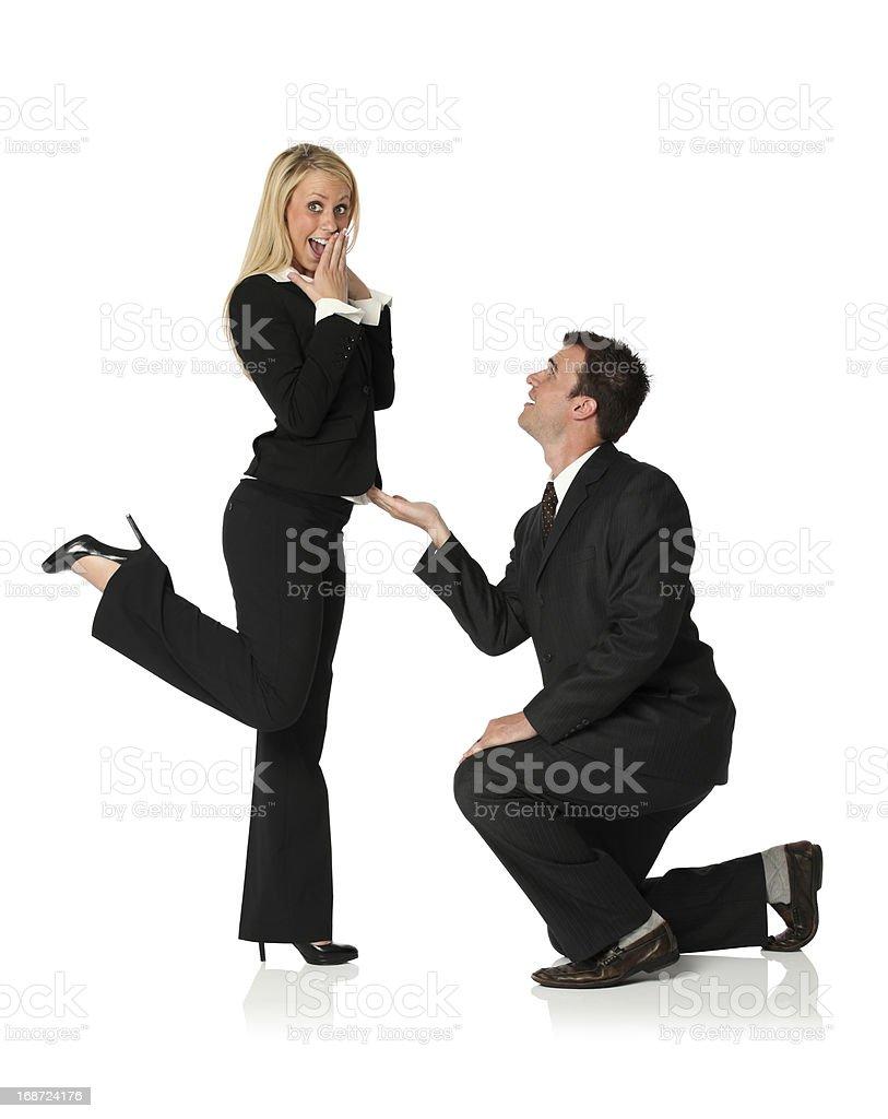 Businessman proposing a businsswoman royalty-free stock photo
