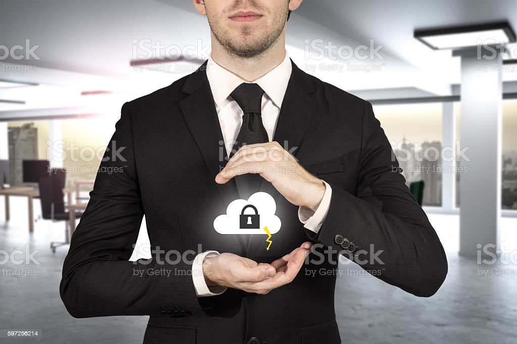 businessman protect cloud lock symbol with hands stock photo