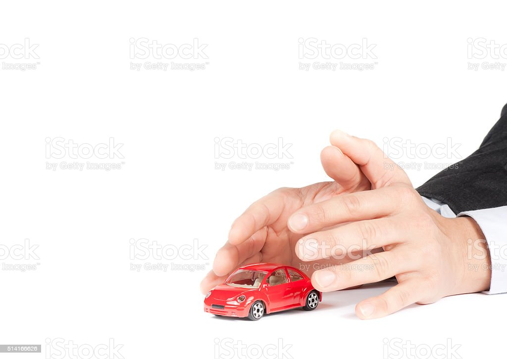 businessman protect with his hands a red car stock photo