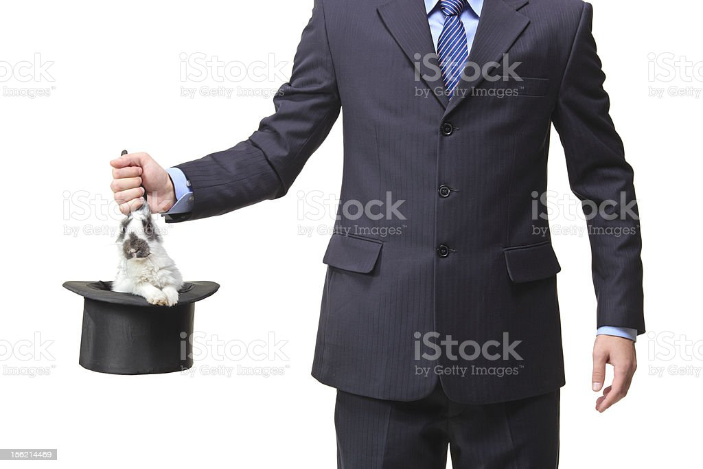 Businessman pulling a rabbit out stock photo