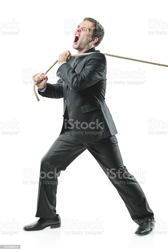 Businessman pulling a rope royalty-free stock photo
