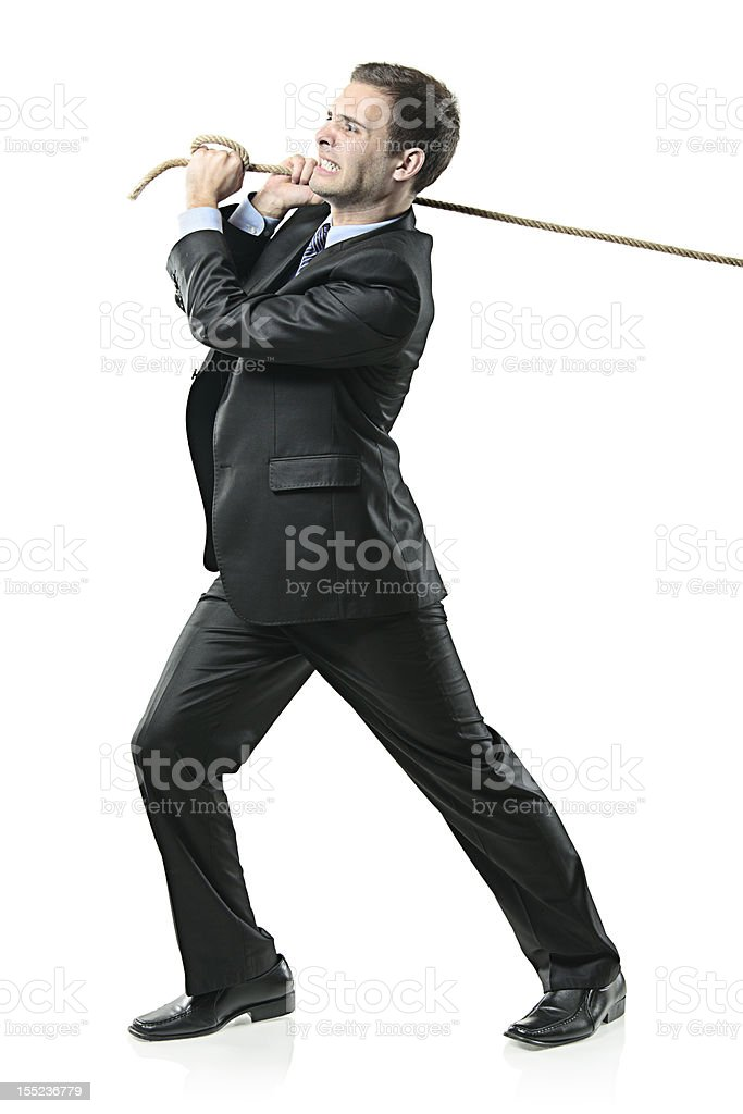 Businessman pulling a rope stock photo