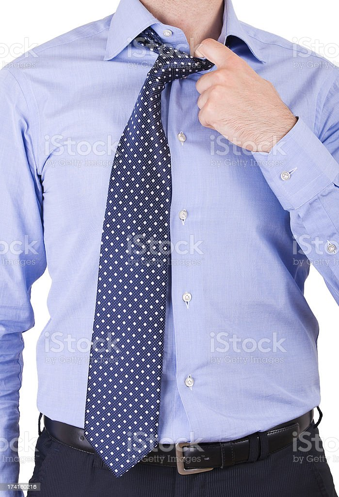 Businessman pulling his collar. royalty-free stock photo