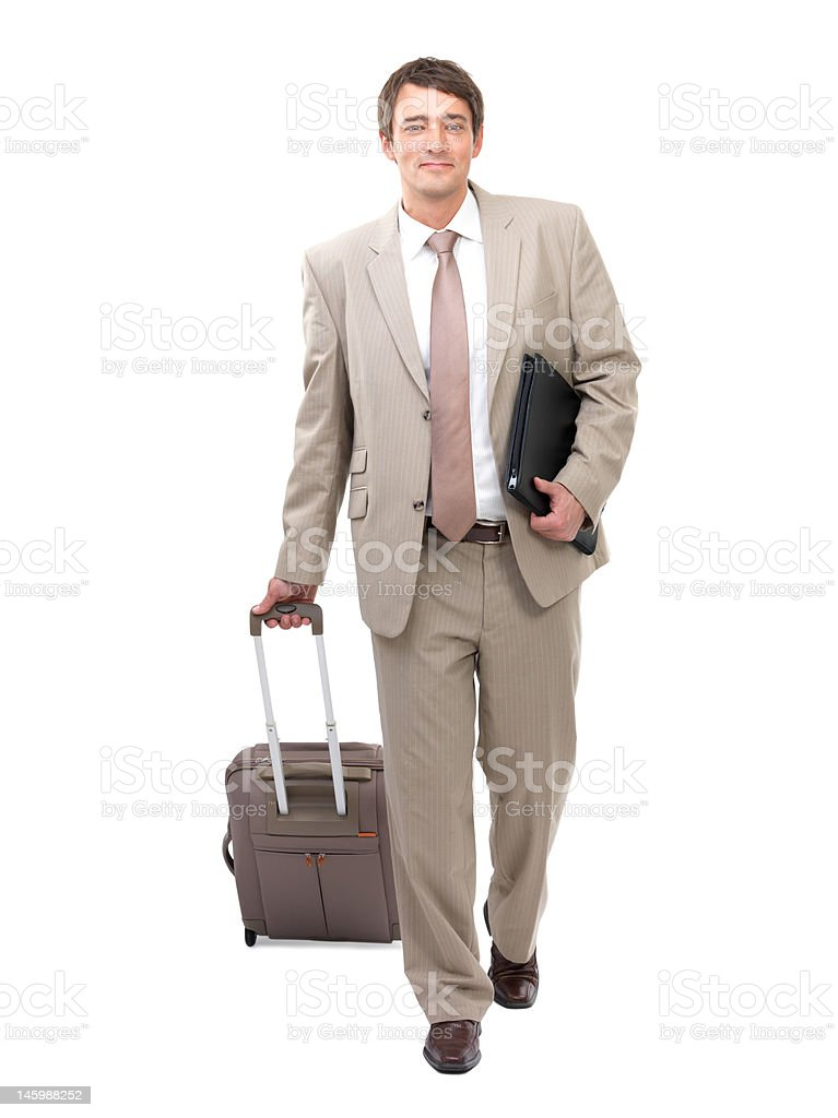 Businessman pulling his luggage royalty-free stock photo