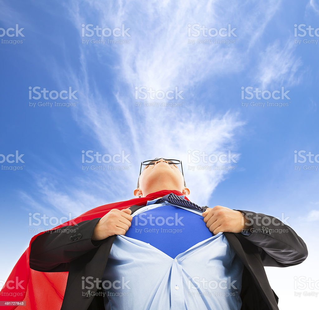 Businessman pulling his t-shirt open stock photo