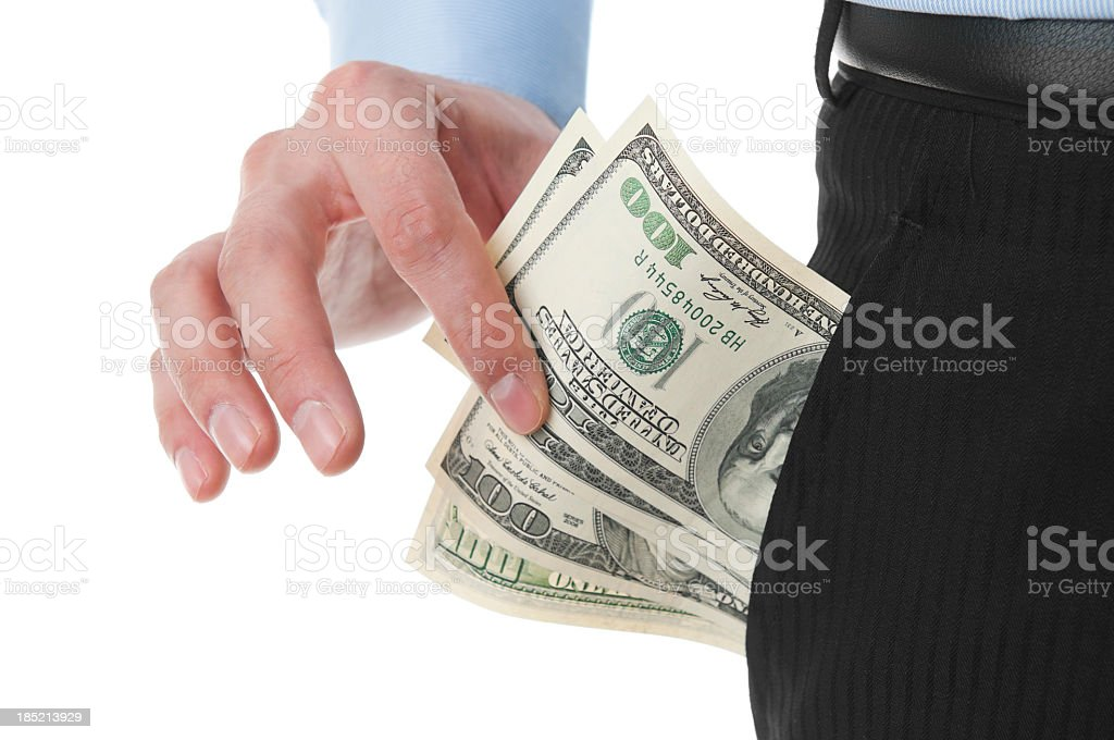 Businessman pulling hundred dollar bills from the pocket, isolated stock photo