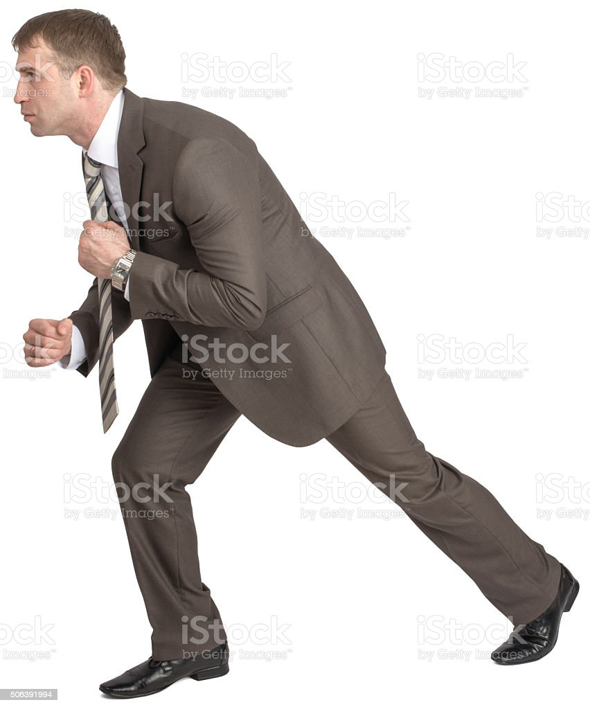Businessman pulling invisible rope stock photo