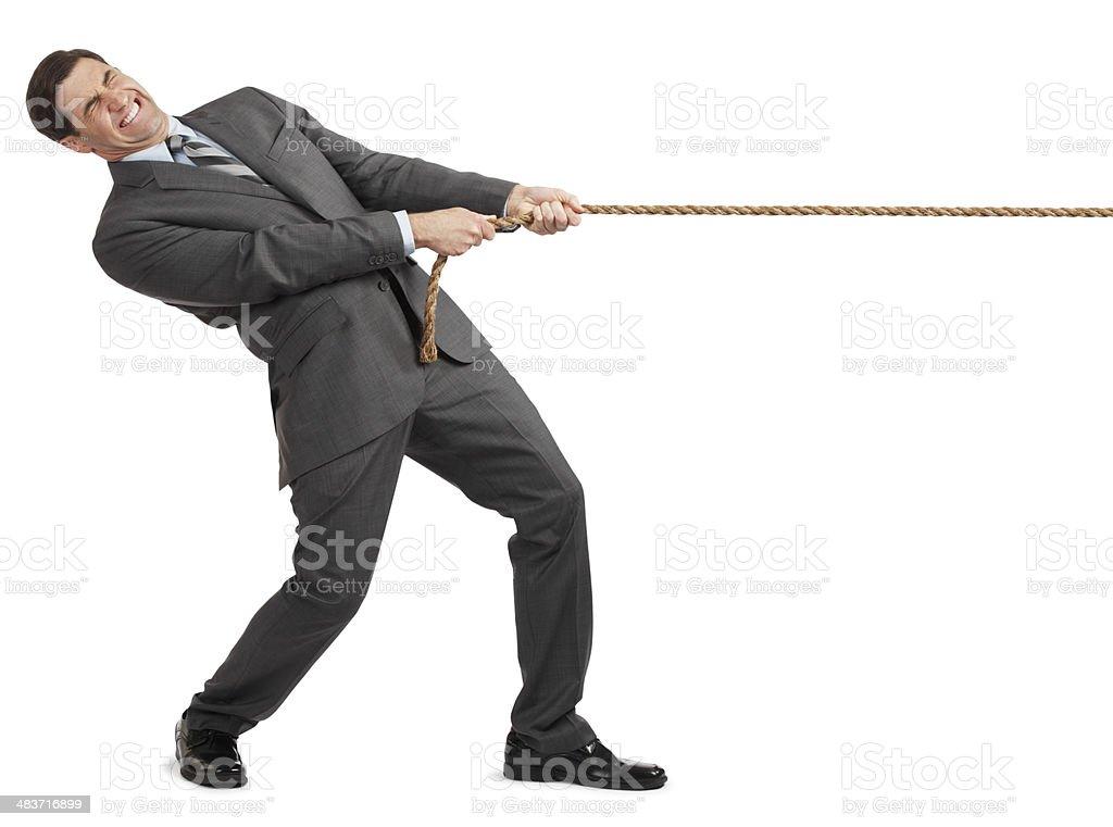 Businessman pulling on rope on white background stock photo