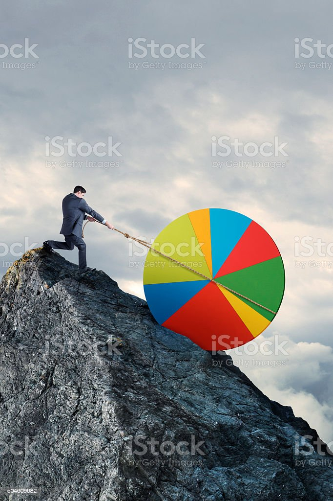 Businessman Pulling Pie Chart Up Steep Hill With Rope stock photo