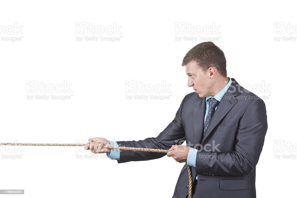 Businessman pulling rope royalty-free stock photo