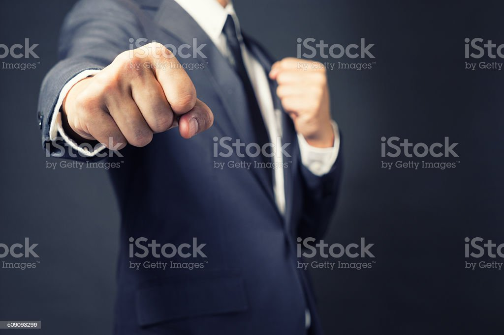 Businessman Punch ready to fight in work. stock photo
