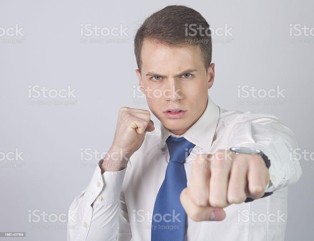 Businessman punching stock photo