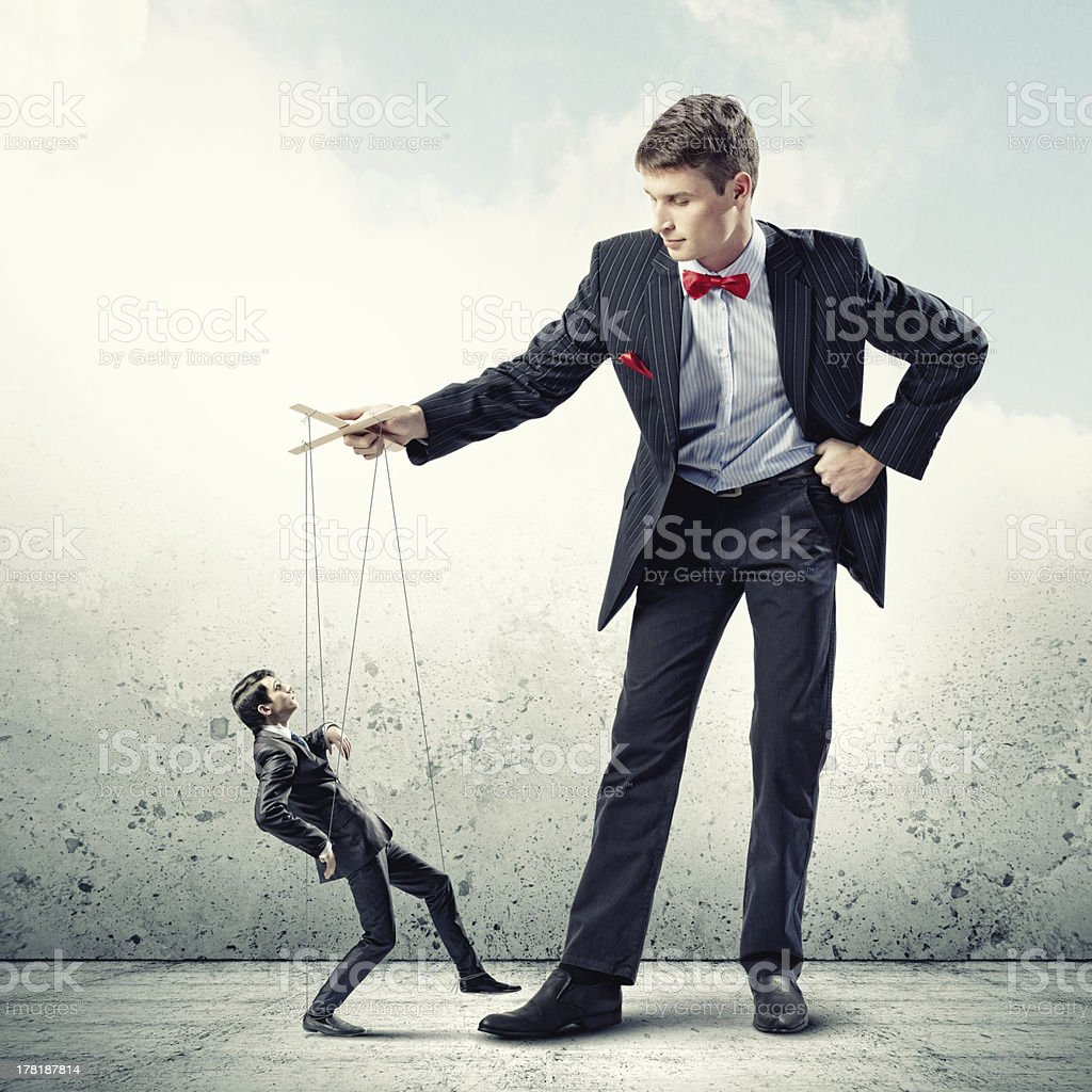 Businessman puppeteer royalty-free stock photo