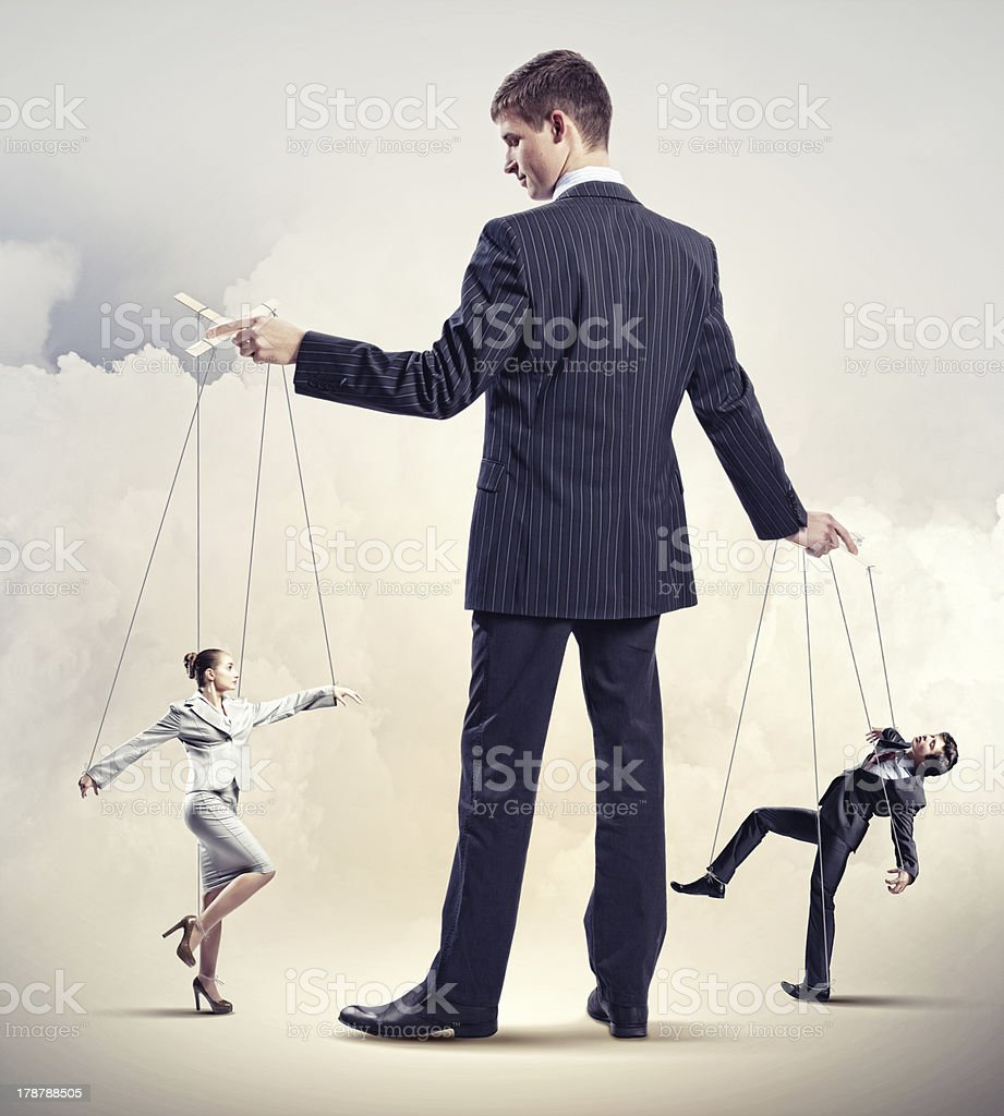 Businessman puppeteer stock photo
