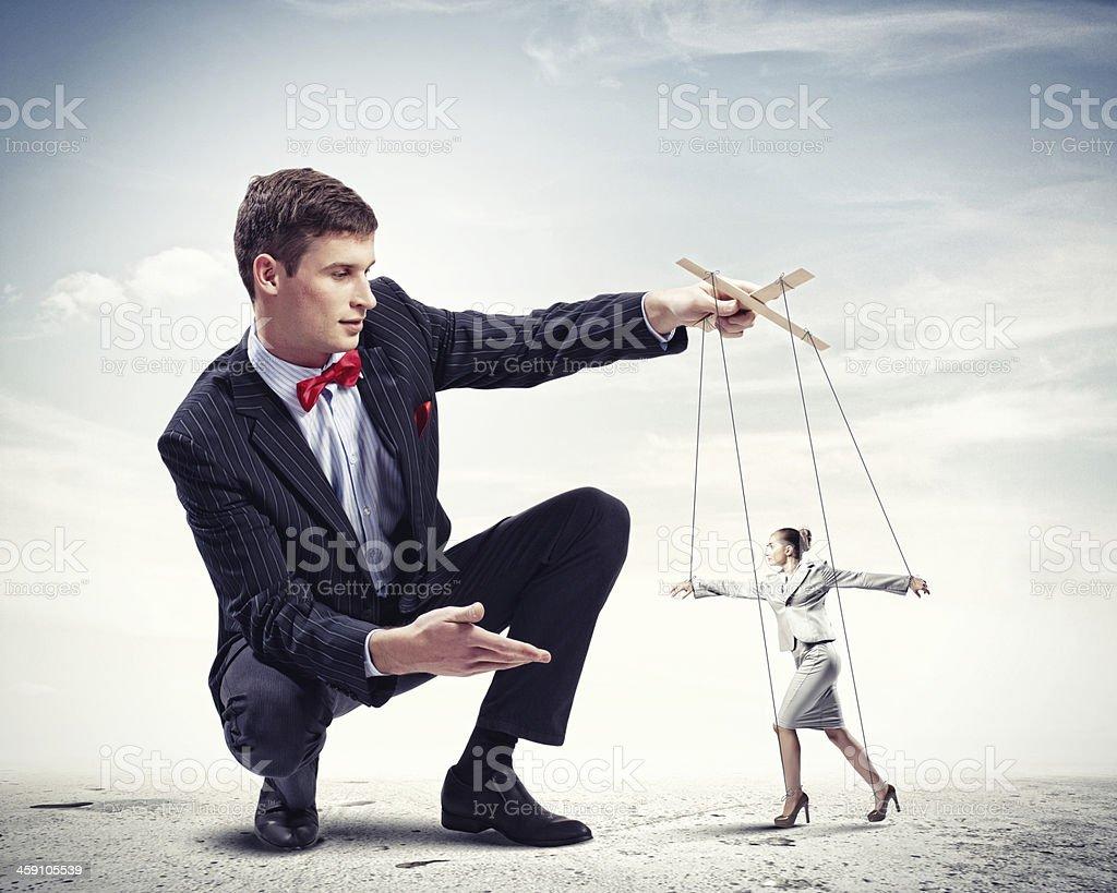 Businessman puppeteer stock photo