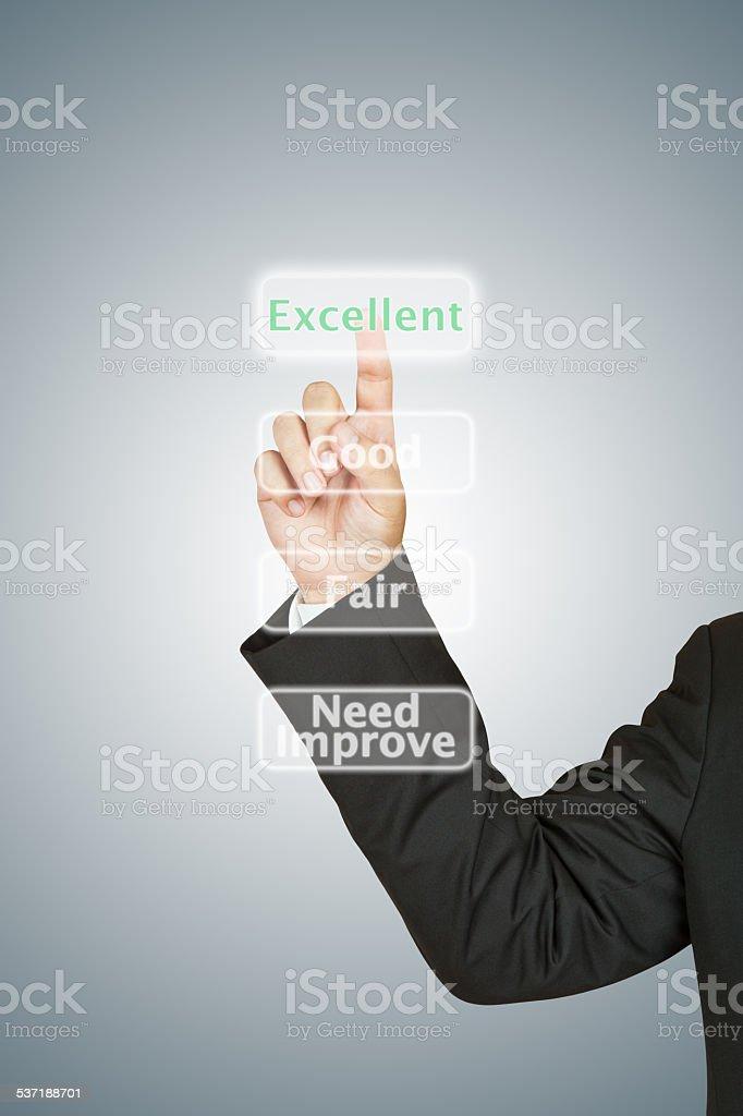 Businessman push excellent button stock photo