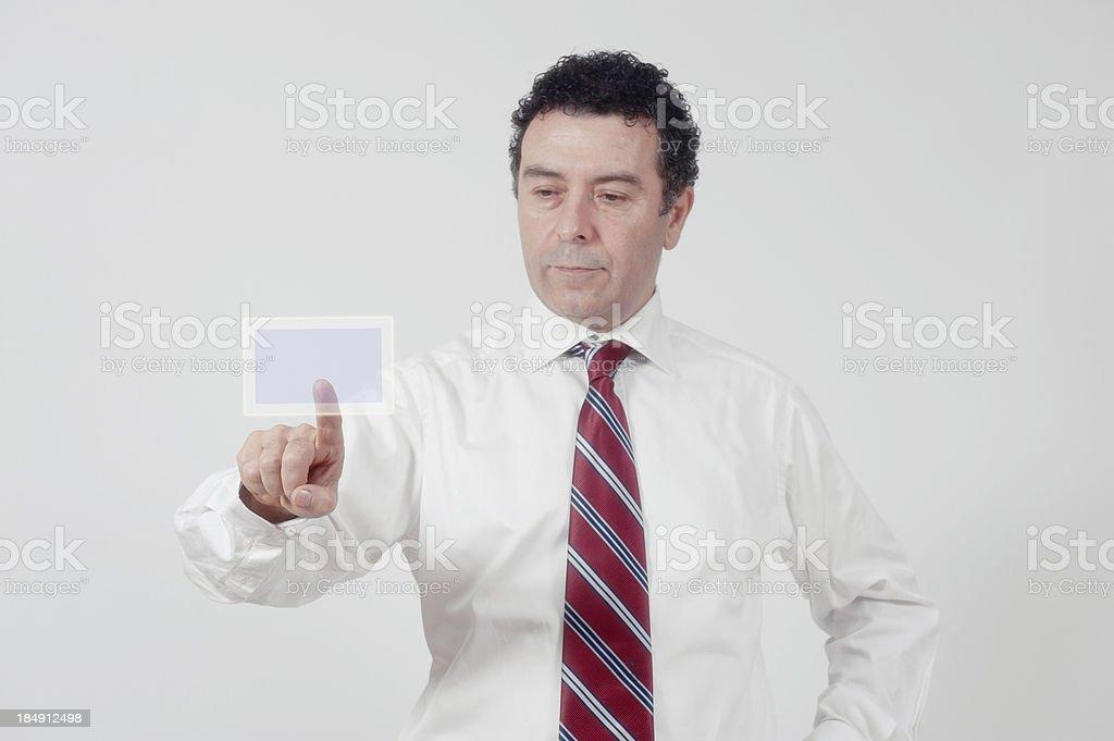 Businessman pushing a button stock photo