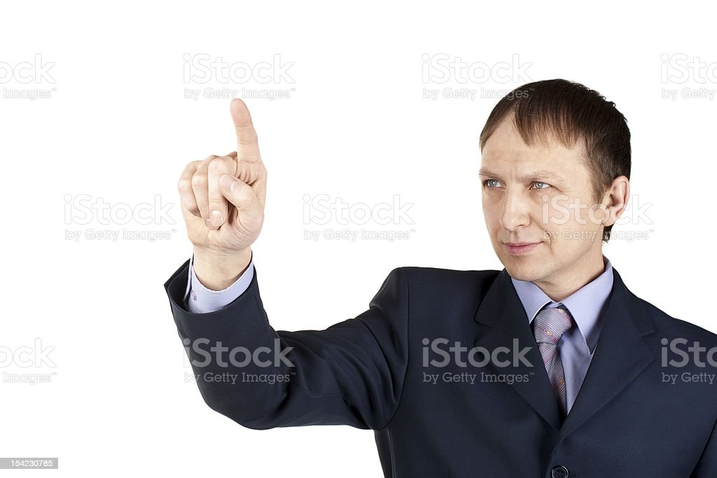 Businessman pushing an imaginary button royalty-free stock photo