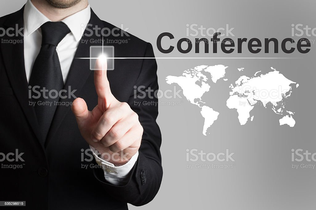 businessman pushing button conference international worldmap stock photo