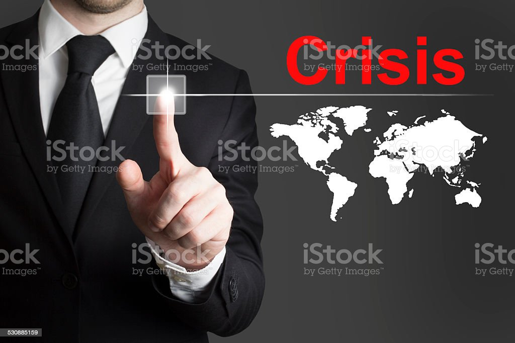businessman pushing button crisis global stock photo