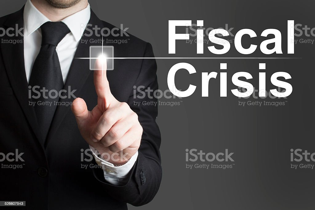 businessman pushing button fiscal crisis stock photo