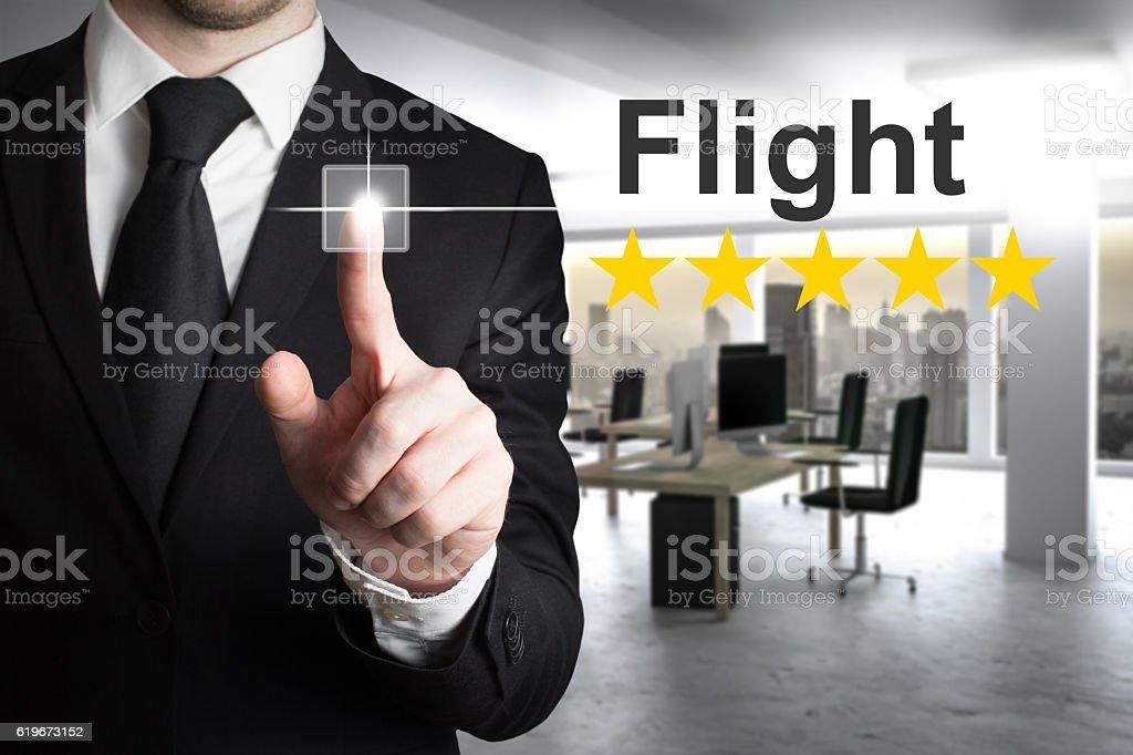 businessman pushing button flight rating stock photo