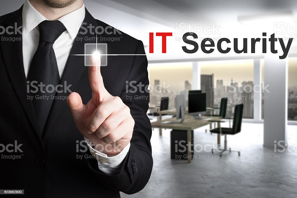 businessman pushing button it security stock photo