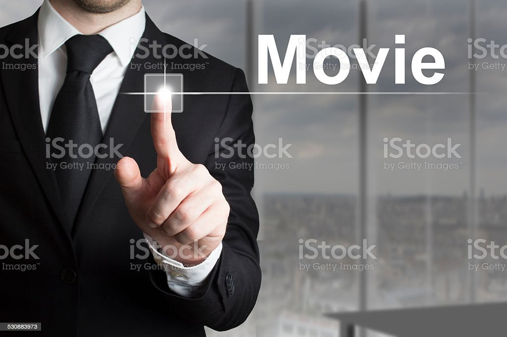 businessman pushing button movie stock photo