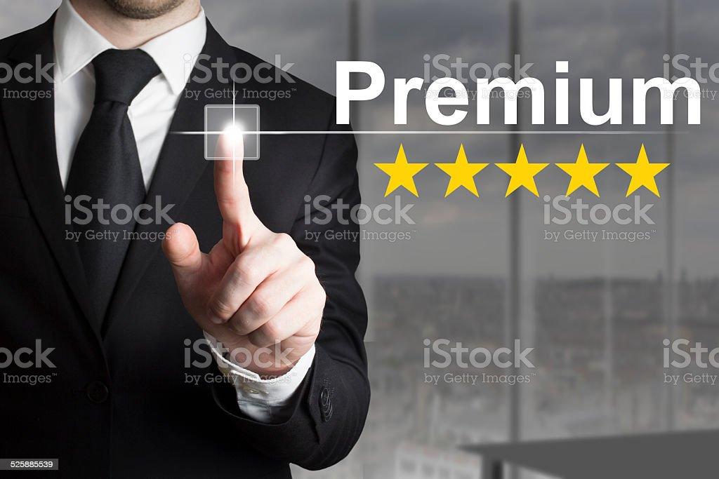 businessman pushing button premium golden rating stars stock photo
