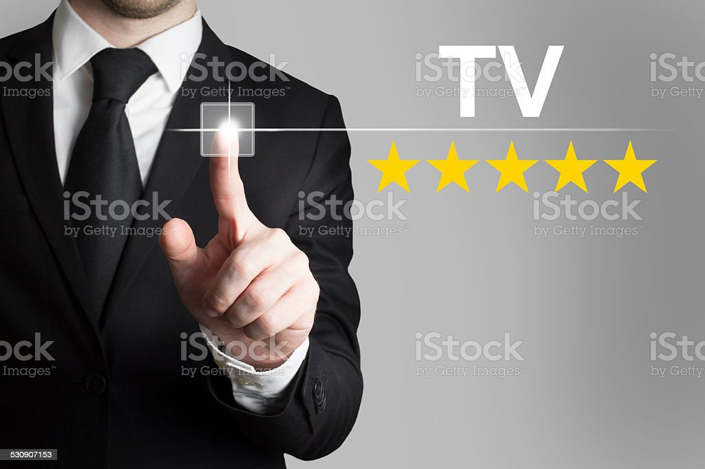 businessman pushing button tv five rating stars stock photo