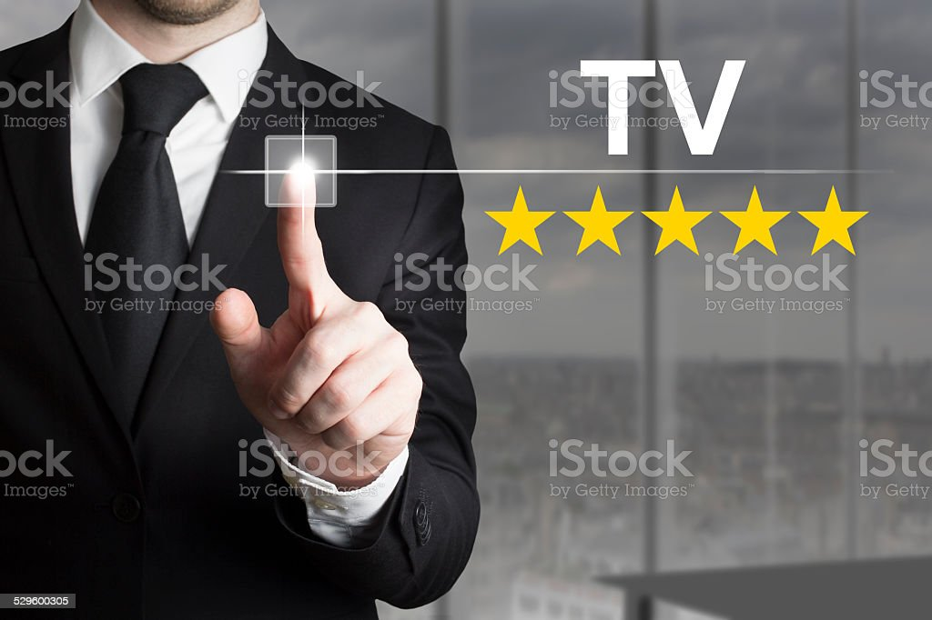 businessman pushing button tv star rating stock photo