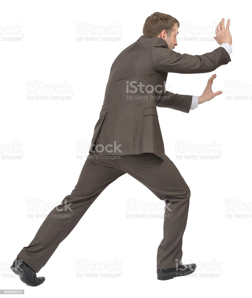 Businessman pushing empty space, side view stock photo